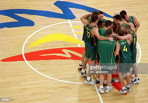 The Australian team huddle together during the Mens Basketball QuarterFinal against Italy at the Sydney Superdome on Day 13 of the Sydney 2000...