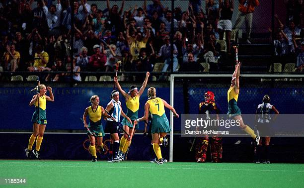 The Australian Women's Hockey Team celebrate their gold medal victory over Argentina during the Women's Hockey Final held at the State Hockey Centre...