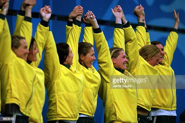 The Australian Women's Water Polo Team celebrates their gold medal victory against the USA 43 in the final of the Women's Water Polo held at the...