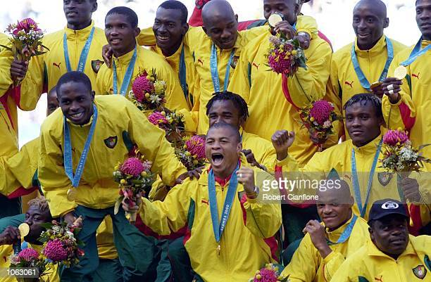 The Cameroon team celebrate after winning Gold in the Men's Gold Medal Soccer Match between Cameroon v Spain at the Sydney 2000 Olympic Games Sydney...