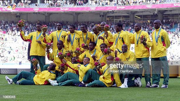 The Cameroon team celebrate after winning the Men's Gold Medal Soccer Match between Cameroon v Spain at the Sydney 2000 Olympic Games, Sydney...