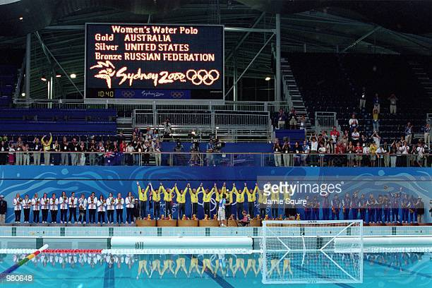 The gold silver and bronze placed countries Australia USA and Russia lineup to receive their medals during the Women's Water Polo held at the Sydney...