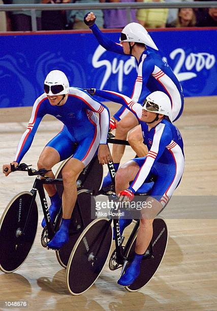 The Great Britain team of Paul Manning Chris Newton Bryan Steel and Bradley Wiggins celebrate qualifying for the Mens Team Pursuit 4000m at the Dunc...