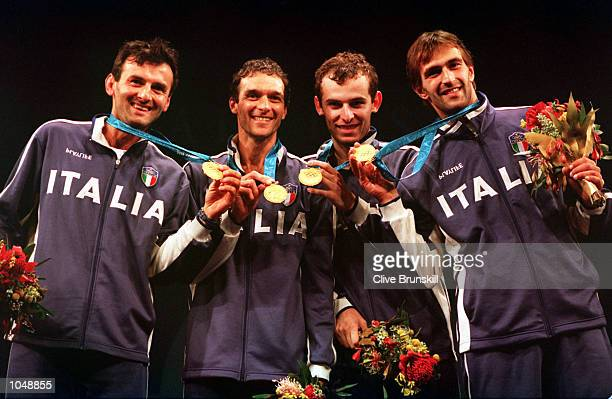 The Italian team celebrate victory over France in the Mens Team Epee Fencing gold medal match at the Sydney Convention and Exhibition Centre in...
