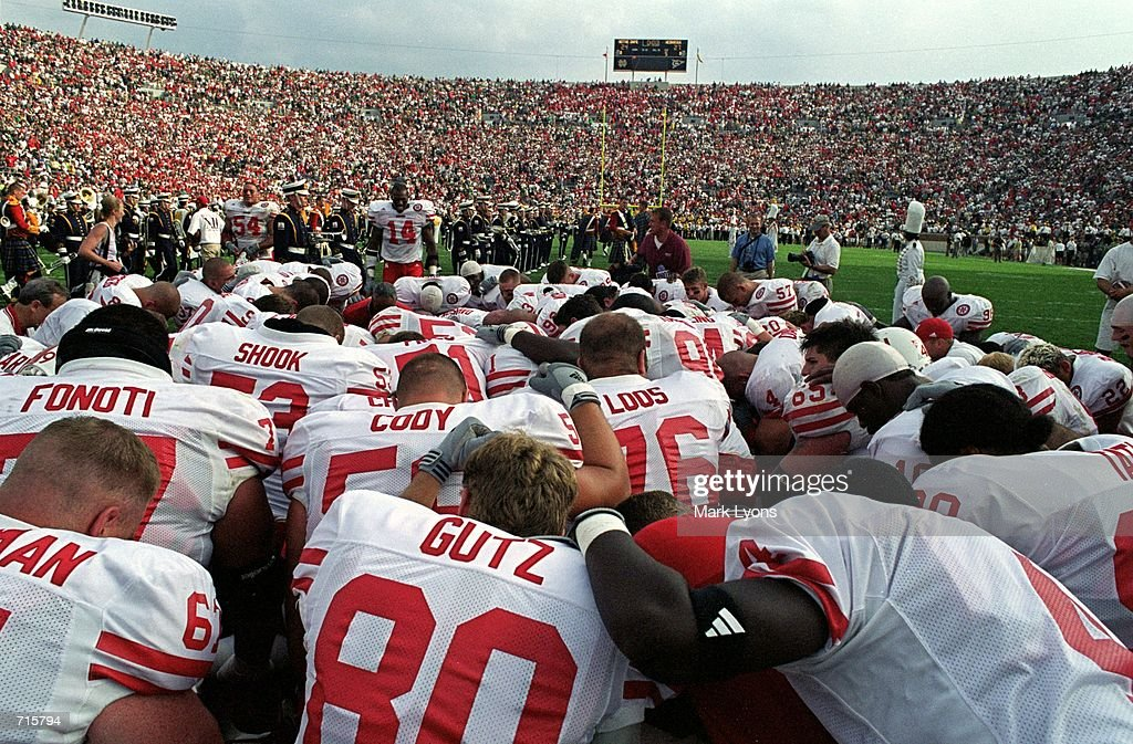 The Nebraska Cornhuskers huddle together for a team prayer before the game against the Notre Dame Fighting Irish at the Notre Dame Stadium in South Bend, Indiana. The Cornhuskers defeated the Fighting Irish 27-24Mandatory Credit: Mark Lyons /Allsport