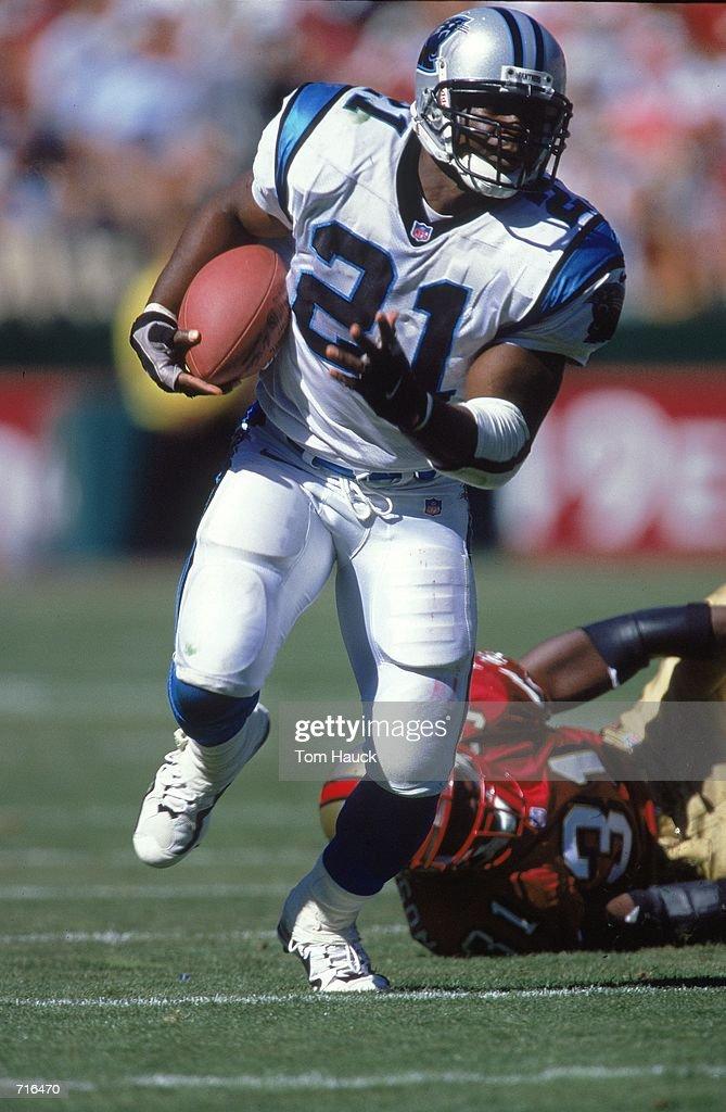 e1def0943 Tim Biakabutuka of the Carolina Panthers carries the ball up field ...