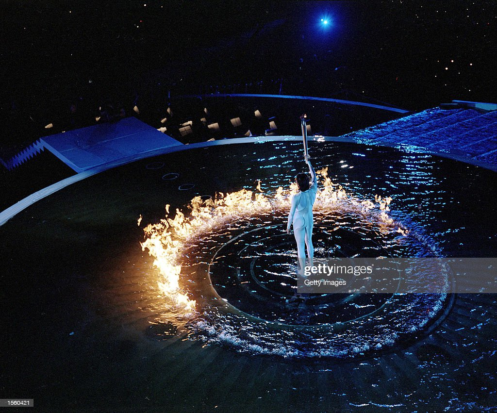Torch Bearer Cathy Freeman of Australia lights the Cauldron with the Olympic Flame during the Opening & Olympic Torch Lighting Ceremony: A Look Back At The Olympic Flame ... azcodes.com