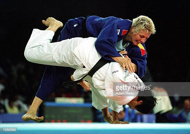 Ursula Martin of Spain attempts to dominate Ulla Werbrouck of Belgium during the womens 70 kilogram Judo event at the Sydney Convention and...