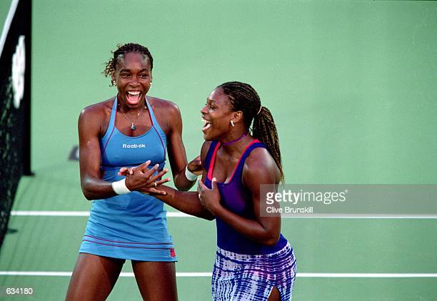 Venus and Serena Williams of the USA celebrate on the court as they win the Gold Medal in the Womens Double Match against Kristie Boogert and Miriam...