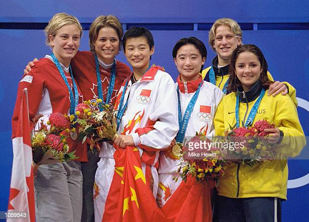 Xue Sang and Na Li of China win gold in the Womens Synchronised 10m Platform Diving beating silver medallists Anne Montminy and Emile Heymans of...