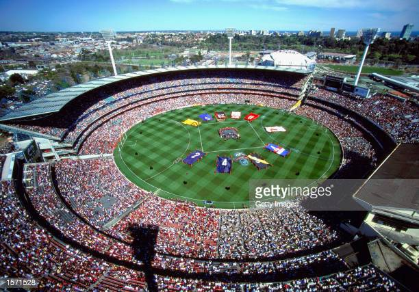 A general view of the Melbourne Cricket Ground during the prematch entertainment before the 2001 AFL Grand Final match between the Essendon Bombers...