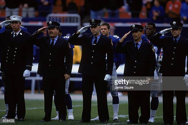 A view of the New York Fire Department saluting the flag during the game between the New Orleans Saints and the New York Giants at Giants Stadium in...