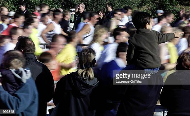 A young spectator on his fathers shoulders to get a better view as the runners flash past during the BUPA Great North Run in Newcastle DIGITAL IMAGE...