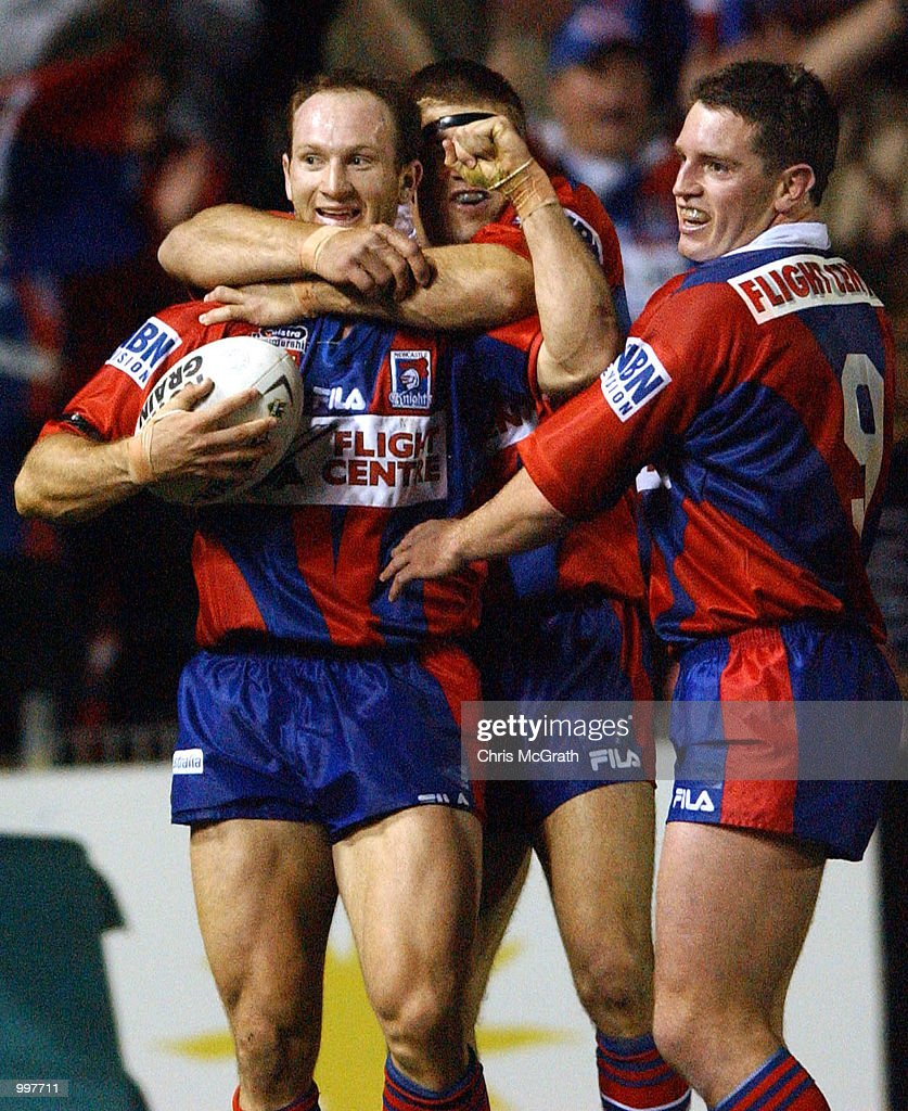 Adam MacDougall #5 of the Knights celebrates after scoring a try during the NRL second qualifying final between the Newcastle Knights and the Sydney Roosters held at Marathon Stadium, Newcastle, Australia. The Knights won the match 40-6. DIGITAL IMAGE Mandatory Credit: Chris McGrath/ALLSPORT