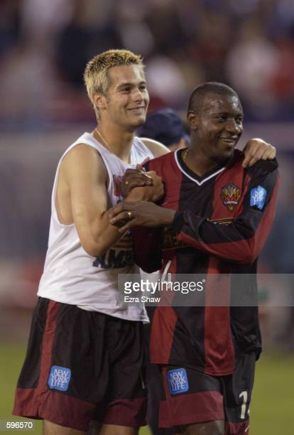 Adolfo Valencia of the New York/New Jersey MetroStars and and teammate Mike Petke celebrate after defeating the Los Angeles Galaxy 41 at Giants...