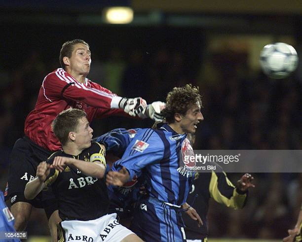 S goalkeeper Daniel Andersson flies above Djurgarden's Louay Chanko during the Swedish national league soccer match between AIK Stockholm and...