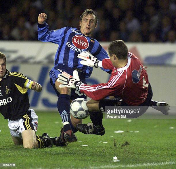 S goalkeeper Daniel Andersson makes a save from Djurgarden's Andreas Johansson during the Swedish national league soccer match between AIK Stockholm...