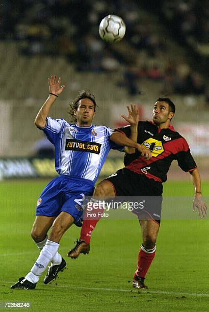 Alex Fernandez of Espanyol is challenged by Quevedo of Rayo Vallecano during the Primera Liga game between Espanyol and Rayo Vallecano at the...