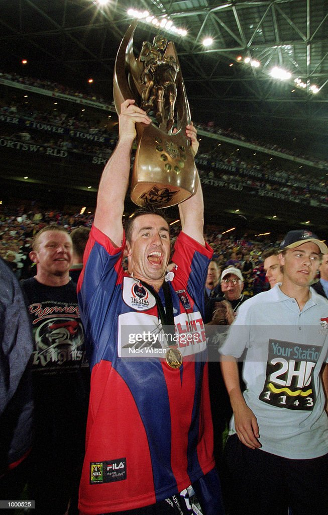 Andrew Johns #7 for Newcastle holds aloft the winners trophy after the teams victory over Parramatta in the NRL Grand Final played between the Parramatta Eels and the Newcastle Knights held at Stadium Australia, Sydney, Australia. Newcastledefeated Parramatta 30-24. Mandatory Credit: Nick Wilson/ALLSPORT