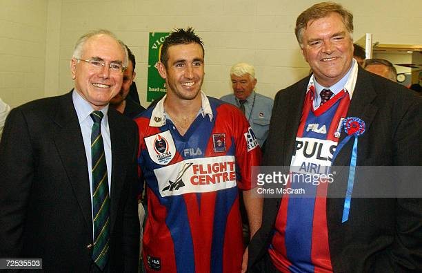Andrew Johns of the Knights with Prime minister John Howard and Opposition leader Kim Beazeley after defeating the Eels during the NRL Grand Final...
