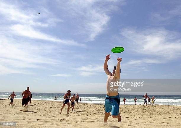 Andrew Ryan dives to catch a frisbee during Day 1 of the Parramatta Eels training camp in preperation for this weekends NRL Grand Final match against...