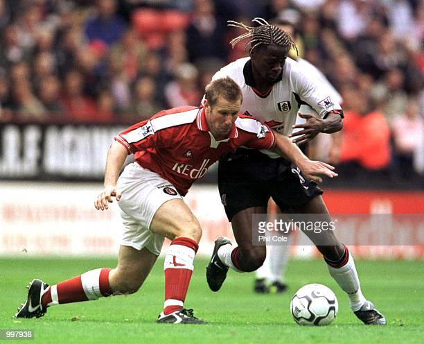 Andy Todd of Charlton is tackled by Louis Saha of Fulham during the FA Barclaycard Premiership match between Charlton Athletic and Fulham FC played...