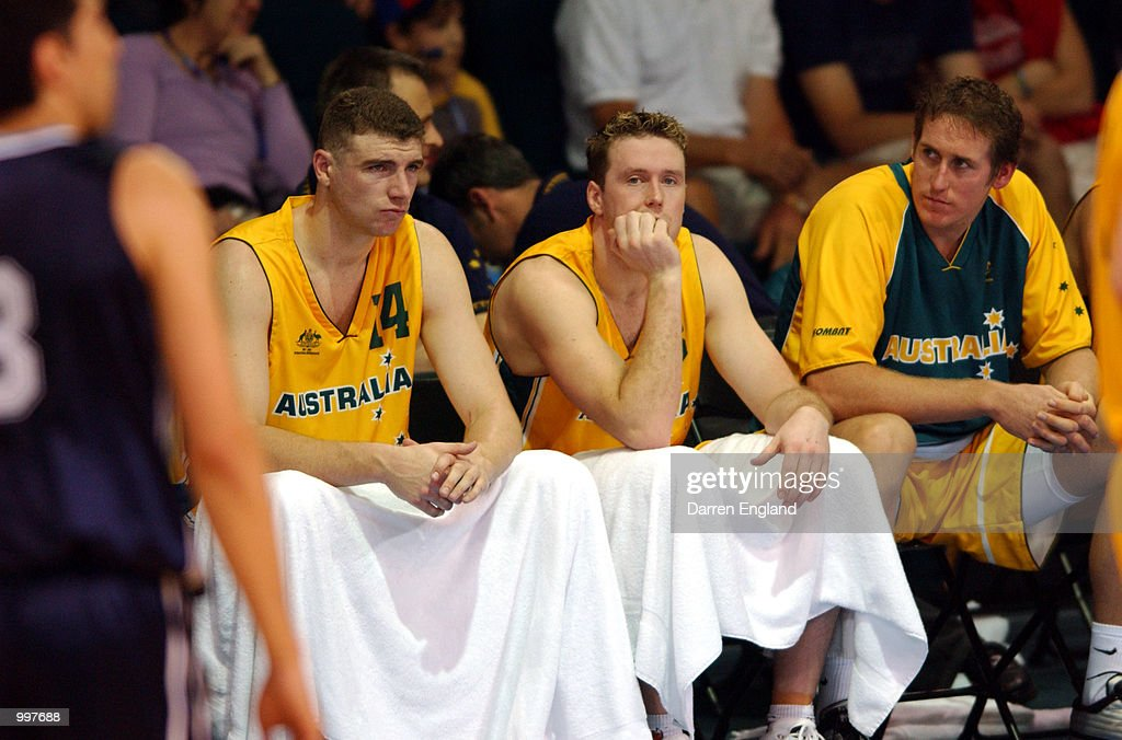 Australian players show their disappointment after losing the Basketball semi-final between Australia and Argentina played at the Brisbane Entertainment and Convention Centre during the Goodwill Games in Brisbane, Australia. Argentina won the match 69 to 63. DIGITAL IMAGE. Mandatory Credit: Darren England/ALLSPORT