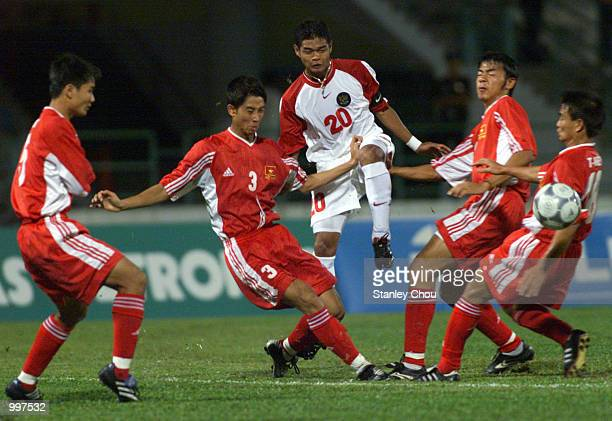 Bambang Pamungkas of Indonesia gets close attention by four Vietnam Players in a Group B match held at the MPPJ Stadium Petaling Jaya Malaysia during...