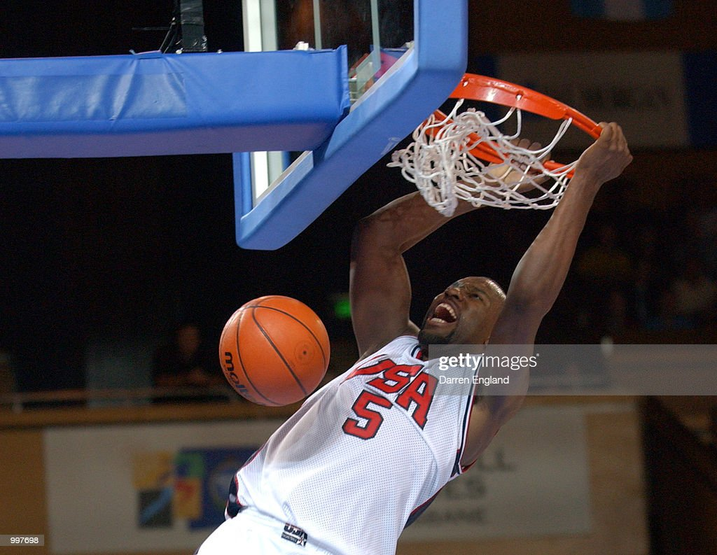 Baron Davis of the USA slam dunks against Brazil during the Basketball semi-final between the USA and Brazil played at the Brisbane Entertainment and Convention Centre during the Goodwill Games in Brisbane, Australia. DIGITAL IMAGE. Mandatory Credit: Darren England/ALLSPORT