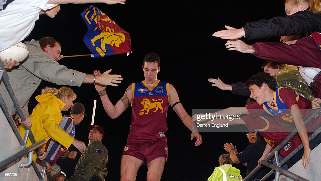 Beau McDonald #43 of Brisbane celebrates winning against Port Adelaide with fans during the AFL Qualifying final match between the Brisbane Lions and the Port Adelaide Power played at the Gabba in Brisbane, Australia. DIGITAL IMAGE. Mandatory Credit: Darren England/ALLSPORT