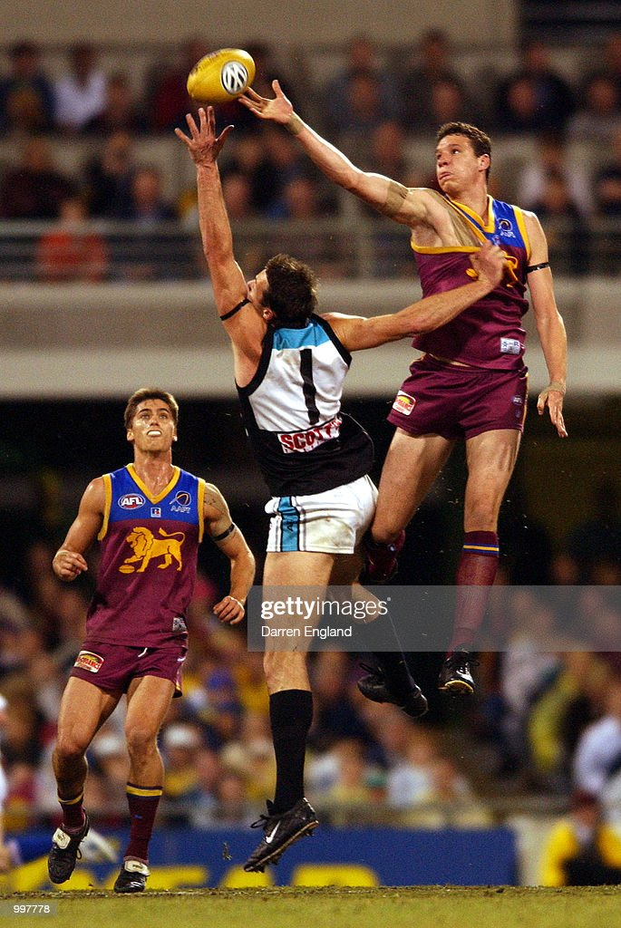Beau McDonald #43 of Brisbane goes for the ball against Matthew Primus #1 of Port Adelaide during the AFL Qualifying final match between the Brisbane Lions and the Port Adelaide Power played at the Gabba in Brisbane, Australia. DIGITAL IMAGE. Mandatory Credit: Darren England/ALLSPORT