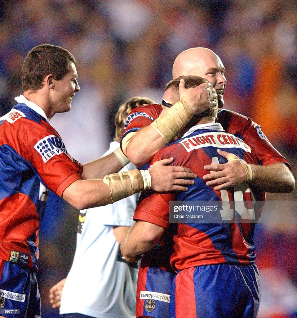 Ben Kennedy #12 and Glenn Grief #16 of the Knights embrace after their victory over the Roosters during the NRL second qualifying final between the Newcastle Knights and the Sydney Roosters held at Marathon Stadium, Newcastle, Australia. The Knights won the match 40-6. DIGITAL IMAGE Mandatory Credit: Chris McGrath/ALLSPORT