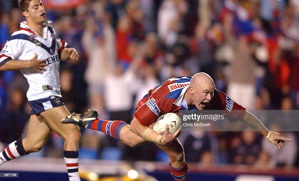 Ben Kennedy #12 of the Knights celebnrates as he scores a try during the NRL second qualifying final between the Newcastle Knights and the Sydney Roosters held at Marathon Stadium, Newcastle, Australia. The Knights won the match 40-6. DIGITAL IMAGE Mandatory Credit: Chris McGrath/ALLSPORT
