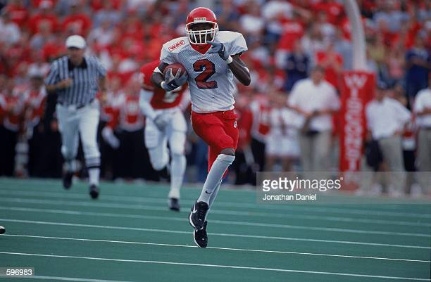 Bernard Berrian of the Fresno State Bull Dogs running with the ball during the game against the Wisconsin Badgers at Camp Randall Stadium in Madison...