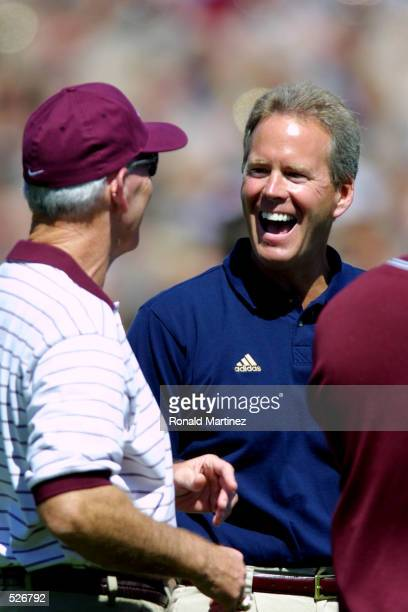 Bob Davie, head coach of Notre Dame chats with R.C Slocum, head coach of Texas A&M before the game at Kyle Field in College Station, Texas. Texas A&M...