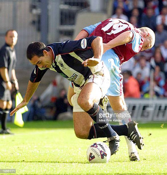 Bob Taylor of West Bromwich Albion fends off Lee Briscoe of Burnley in the Nationwide League Division One match at The Hawthorns West Bromwich West...