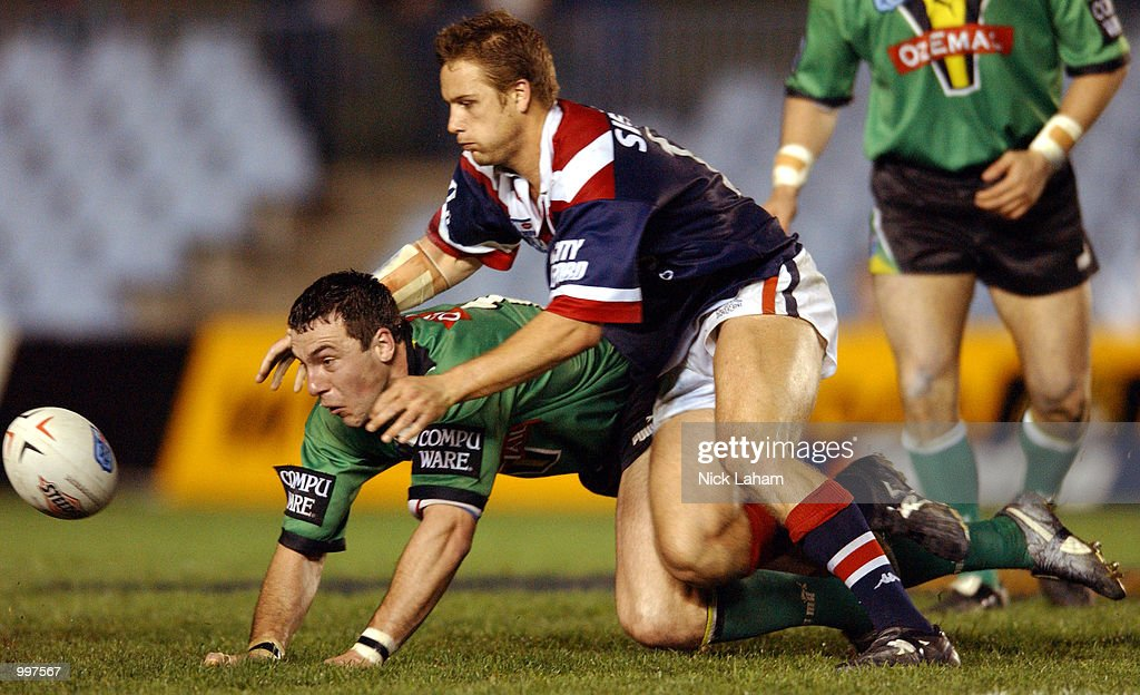Brad Kelly #12 of the Raiders dives for the ball under pressure from a Roosters defender during the NRL first division NRL qualifying final between the Canberra Raiders and the Sydney Roosters held at Toyota Park, Sydney, Australia. DIGITAL IMAGE Mandatory Credit: Nick Laham/ALLSPORT