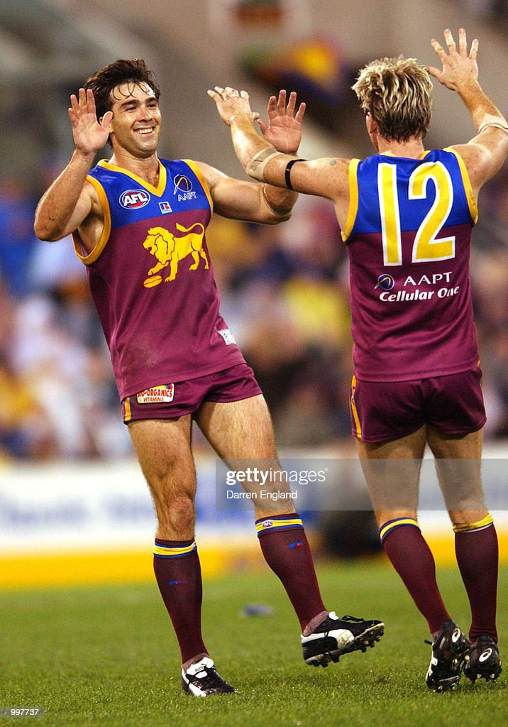 Brad Scott #5 and Jason Akermanis #12 of Brisbane celebrate kicking a goal against Port Adelaide during the AFL Qualifying final match between the Brisbane Lions and the Port Adelaide Power played at the Gabba in Brisbane, Australia. DIGITAL IMAGE. Mandatory Credit: Darren England/ALLSPORT