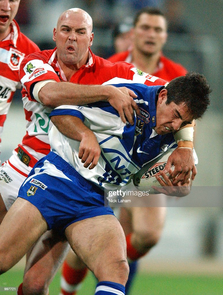 Braith Anasta #6 of the Bulldogs is tackled by Paul McGregor #4 of the Dragons during the NRL qualifying final between the Bulldogs and the St George Illawarra Dragons held at the Sydney Showground, Homebush Bay, Sydney, Australia. DIGITALIMAGE Mandatory Credit: Nick Laham/ALLSPORT