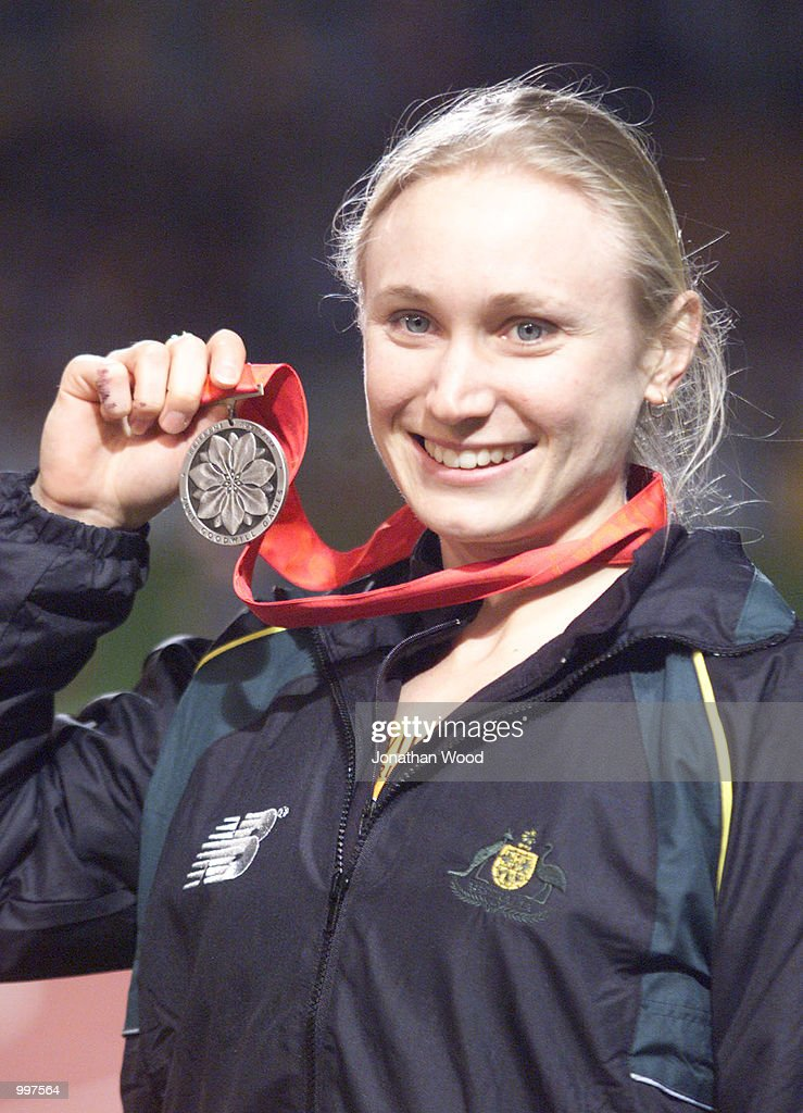 Bronwyn Thompson of Australia celebrates with her silver medal after the Womens Long Jump in which she broke the Australian record with a jump of 6.88 Metres during the athletics at the ANZ Stadium during the Goodwill Games in Brisbane, Australia. DIGITAL IMAGE Mandatory Credit: Jonathan Wood/ALLSPORT