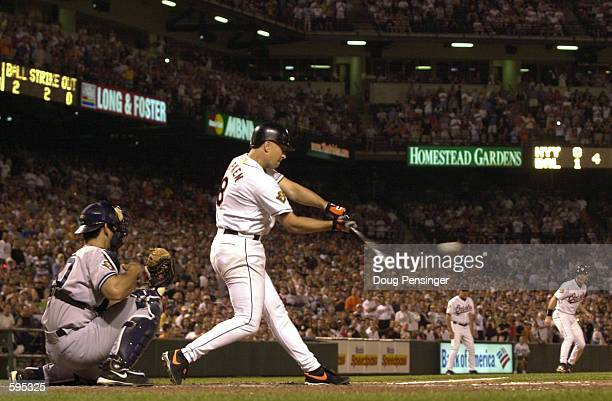 Cal Ripken Jr. #8 of the Baltimore Orioles hits a sacrifice fly to score Chris Richard and give the Orioles a 2-0 fourth inning lead over the New...