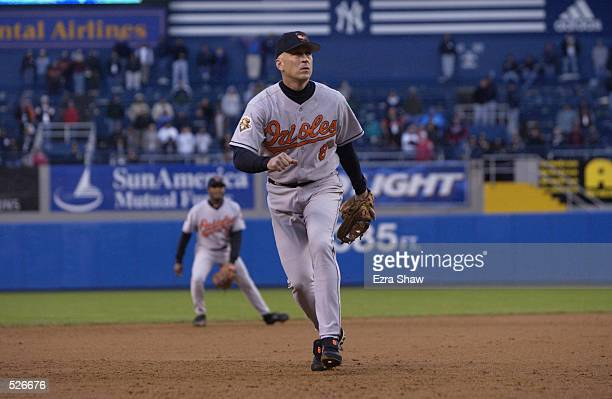 Cal Ripken Jr of the Baltimore Orioles has his eyes on the ball during his final game against the New York Yankees at Yankee Stadium in the Bronx New...