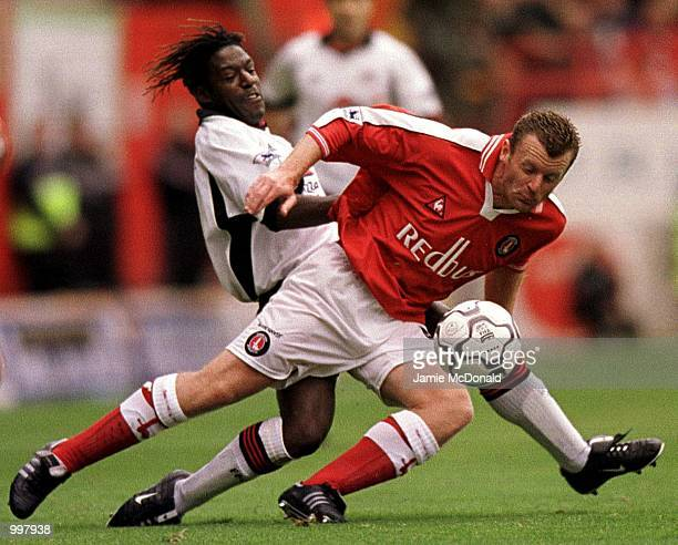 Charlton captain Graham Stuart is tackled by Rufus Brevett of Fulham during the FA Barclaycard Premiership match between Charlton Athletic and Fulham...