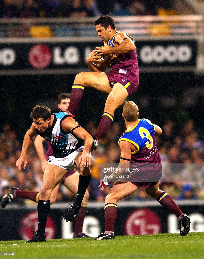 Chris Johnson #2 of Brisbane marks over the top of Matthew Primus #1 of Port Adelaide during the AFL Qualifying final match between the Brisbane Lions and the Port Adelaide Power played at the Gabba in Brisbane, Australia. DIGITAL IMAGE. Mandatory Credit: Darren England/ALLSPORT