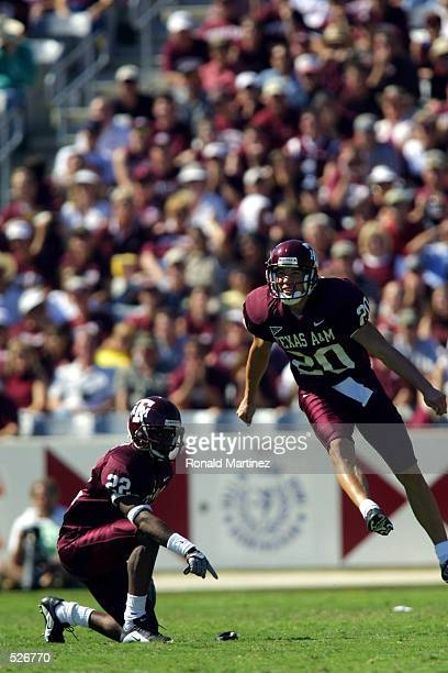 Cody Scates of Texas A&M leaps up as he delivers a kick set up by Sammy Davis during the game against Notre Dame at Kyle Field in College Station,...