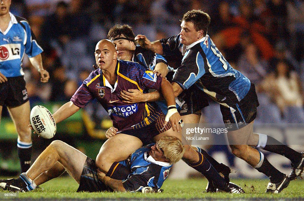 Corey Parker #16 of the Broncos offloads under pressure from the Sharks defence during the NRL qualifying final between the Sharks and the Brisbane Broncos held at Toyota Park, Sydney, Australia. DIGITAL IMAGE Mandatory Credit: Nick Laham/ALLSPORT