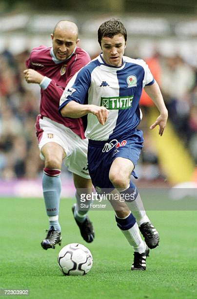 Damien Johnson of Blackburn holds off Hassan Kachloul of Villa during the match between Aston Villa and Blackburn Rovers in the FA Barclaycard...