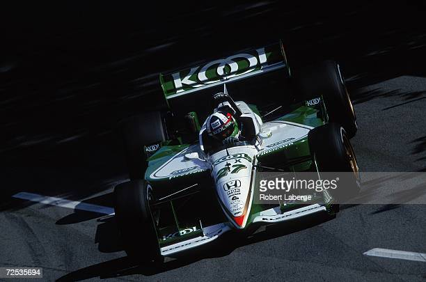 Dario Franchitti of Great Britian who drives the Honda Reynard for Team KOOL Green driving on the track during the Molson Indy part of the CART FedEx...