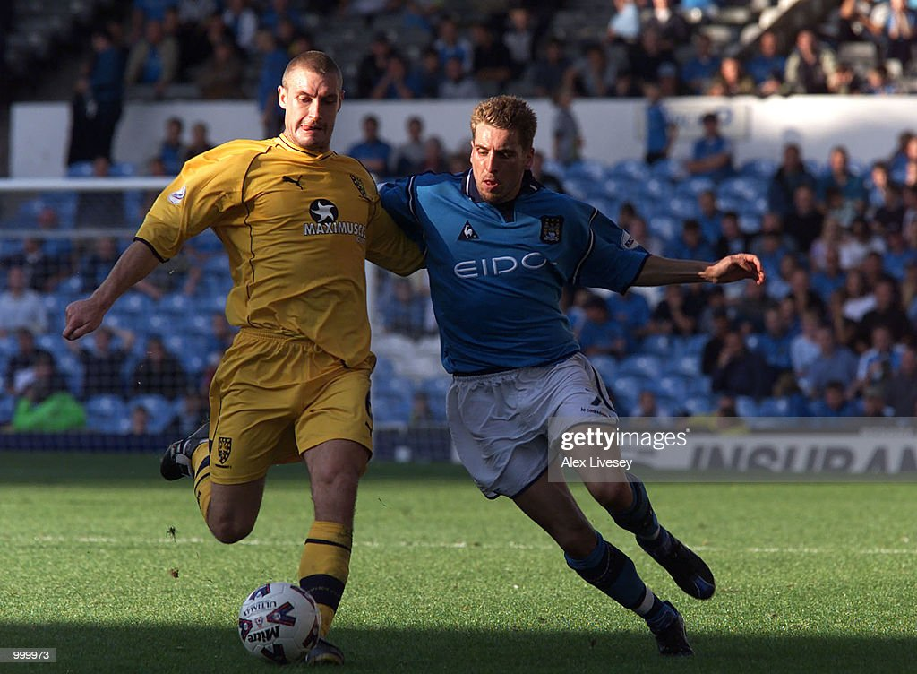Darren Holloway of Wimbledon holds off Darren Huckerby of Man City during the Nationwide League Division One game between Manchester City and Wimbledon at Maine Road, Manchester. DIGITAL IMAGE. Mandatory Credit: Alex Livesey/ALLSPORT