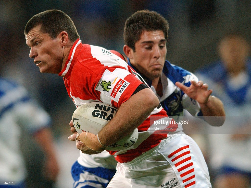 Darren Treacy #11 of the Dragons attempts to break the tackle of Braith Anasta #6 of the Bulldogs during the NRL qualifying final between the Bulldogs and the St George Illawarra Dragons held at the Sydney Showground, Homebush Bay, Sydney, Australia. DIGITAL IMAGE Mandatory Credit: Nick Laham/ALLSPORT